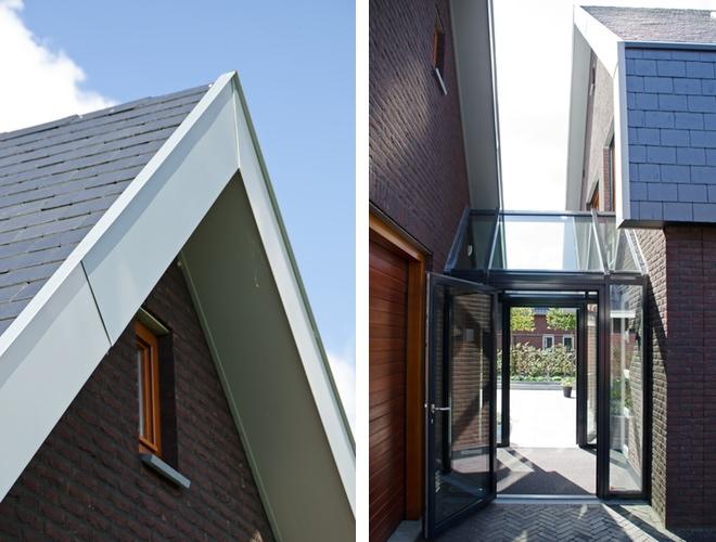 Vrijstaande woning in haarsteeg met leien dak en larikshouten kozijnen op een ruimte voor ruimte - Glazen ingang ...